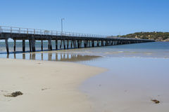 Victor Harbor Jetty, Fleurieu Peninsula, South Australia. Victor Harbor jetty at low tide, looking out to Granite Island, Fleurieu Peninsula, South Australia Royalty Free Stock Photography