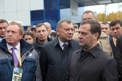 Victor Korman, Yuri Borisov and Dmitry Medvedev. NIZHNY TAGIL, RUSSIA - SEP 26: General Director Automobile plant URAL Victor Korman, Deputy Minister of defense Royalty Free Stock Photography