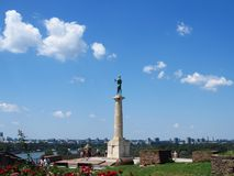 Victor monument, Belgrade, Serbia. Group of tourists visiting Victor monument on Kalemegdan fortress, Belgrade, Serbia.n royalty free stock photo