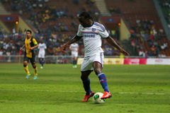 Victor Moses. SHAH ALAM - JULY 21: Chelsea Football Club player Victor Moses controls the ball in a friendly match with the Malaysian national team in Stadium Royalty Free Stock Images