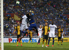 Victor Moses. SHAH ALAM - JULY 21: Chelsea Football Club player Victor Moses (white jersey #13) attempts to head the ball at the Malaysian goal in a friendly Royalty Free Stock Photos