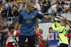 Victor Valdes with young football players. Victor Valdes, from FC Barcelona during the friendly football match between FC Dinamo Bucharest and FC Barcelona, 11th Royalty Free Stock Photography
