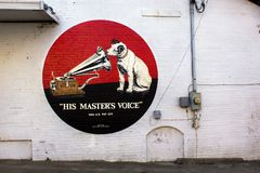 Berryville, Arkansas, United States - circa June 2016 Victor Victrola and dog painted advertisement on building stock photography
