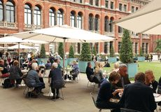 People spending their sunday afternoon in the courtyard at the Victoria and Albert Museum in London. Victoria and Albert Museum, the John Madejski Garden. V&A royalty free stock photos