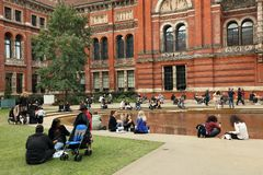 People spending their sunday afternoon in the courtyard at the Victoria and Albert Museum in London. Victoria and Albert Museum, the John Madejski Garden. V&A royalty free stock images
