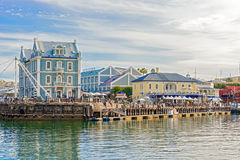 Victoria and Alfred Waterfront in Cape Town, South Africa. Cape Town, South Africa - May 14, 2015: Tourists walking by the buildings at Victoria and Alfred Royalty Free Stock Image
