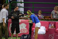 Victoria Azarenka autographing. DOHA-QATAR: FEBRUARY 17: Tennis Player Victoria Azarenka at Qatar Total Open on February 17, 2012 in Doha, Qatar. The event was stock image