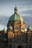 Victoria, British Columbia Parliament Building. The historic Victoria, BC government building seen at sunset in the inner harbor of this beautiful city Stock Image