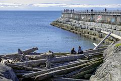 VICTORIA, CANADA - MARCH 9, 2018: View of Ogden Point Breakwater, a popular walk near Canada`s busiest deep water port facility,. Taken in Victoria, British royalty free stock photography