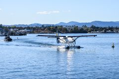 Single Otter Saltspring Air Seaplane about to take flight from downtown Victoria, British Columbia stock image