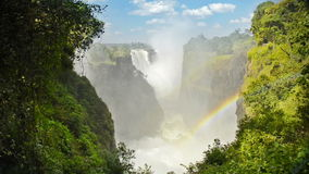Victoria Falls. Devils Cataract or Mosi-oa-Tunya waterfall in southern Africa on the Zambezi River at the border of Zambia and Zimbabwe in high definition stock video