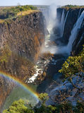 Victoria Falls. A general view with a rainbow. National park. Mosi-oa-Tunya National park. and World Heritage Site. Zambiya. Zimbabwe. An excellent royalty free stock image