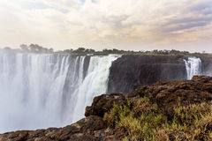 The Victoria falls with mist from water Royalty Free Stock Photography