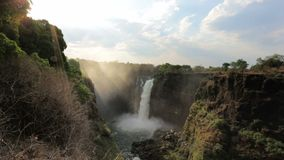 The Victoria falls with mist from water stock video