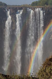 Victoria Falls in October with rainbow crossing Stock Image