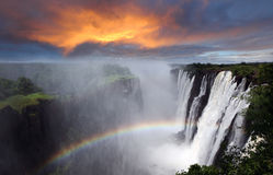 Victoria Falls, rainbow, Zambia. Victoria Falls, sunset with rainbow, dramatic sky, Zambia stock images
