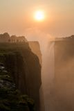 Victoria Falls sunset with tourist in the cliff Stock Photos