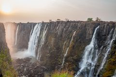 Victoria Falls sunset from Zambia side, red sun Stock Photos
