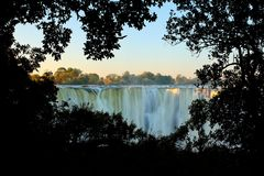 Victoria Falls, waterfall in southern Africa on the Zambezi River at the border between Zambia and Zimbabwe. Landscape in Africa. A lot of water durring summer royalty free stock photo