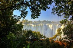 Victoria Falls, waterfall in southern Africa on the Zambezi River at the border between Zambia and Zimbabwe. Landscape in Africa. A lot of water durring summer stock photography