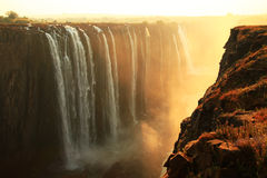 Victoria Falls - Zambezi River. Early morning picture of the Victoria Falls in Zimbabwe. This waterfall is creating the biggest curtain of falling water in the Royalty Free Stock Photo