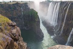 Victoria Falls from Zambia side at dusk, rocks in the foreground Royalty Free Stock Photography