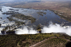 Victoria Falls - Zimbabwe. Aerial view of the waters of the Zambezi River going over the edge into the chasm of Victoria Falls on the border of Zambia and stock photography