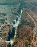 Victoria Falls in Zimbabwe at drought, aerial shot. Made from a helicopter Royalty Free Stock Photography
