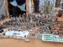 VICTORIA FALLS ZIMBABWE - OCTOBER 24: statuettes carved from stone,   24. 10, 2014 marketplace in Victoria falls Zimbawe. Royalty Free Stock Photography