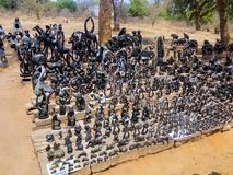 VICTORIA FALLS ZIMBABWE - OCTOBER 24: statuettes carved from stone,   24. 10, 2014 marketplace in Victoria falls Zimbawe. Stock Photo