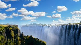 Victoria Falls and Zambezi River against a blue sky, Zimbabwe. Victoria falls Zimbawbe panoramic view against blue cloudy sky stock video footage