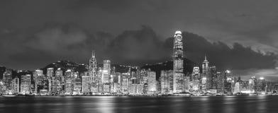 Victoria Harbor en Hong Kong en la oscuridad Imágenes de archivo libres de regalías