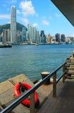 Victoria harbor, Hong Kong. Ring-buoy at the pier of Hong Kong seafront Stock Image