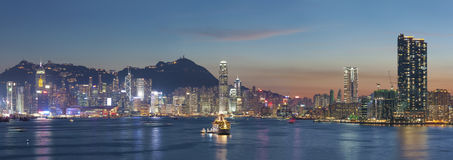 Victoria Harbor of Hong Kong city at dusk. Panorama of Victoria Harbor of Hong Kong city at dusk Royalty Free Stock Image