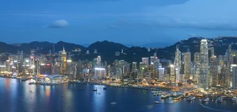 Victoria harbor of Hong Kong city at dusk. Panorama view of Victoria harbor of Hong Kong city at dusk Stock Photo