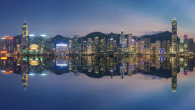 Victoria Harbor in Hong Kong at dusk. Panorama of Victoria Harbor in Hong Kong at dusk Royalty Free Stock Photos