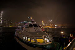 Victoria Harbor. Many people sit on the ship cross the Harbor Stock Photo