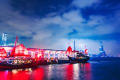 Victoria harbor night view with ships royalty free stock photography