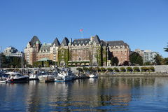 Victoria harbour. Victoria,Canada-June 30th,2015: tourists enjoying the inner harbour,with the Fairmont Empress hotel in background Stock Image