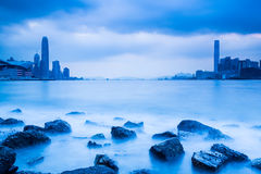 Victoria Harbour of Hong Kong in blue. With buildings stock photo