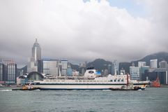 Jimei Cruise ship sails through Victoria harbour, Hong Kong royalty free stock photo