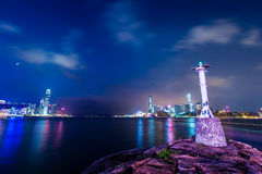 Victoria Harbour of Hong Kong at night. With buildings stock photo