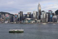 Victoria Harbour in Hong Kong. Pretty Victoria Harbour scene in Hong Kong. a ferry cross the harbour. many modern buildings. city center Stock Images