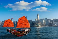 Victoria Harbour with junk ship in Hong Kong stock images