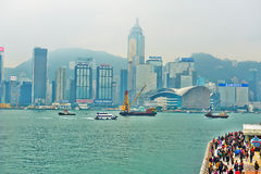 The Victoria Harbour and tourists Stock Images