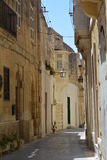 Victoria historical street. Street in Victoria (Ir-Rabat Għawdex) on Gozo Island. Narrow historical lane Royalty Free Stock Images