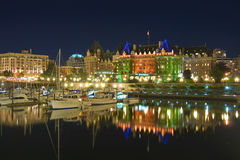 Victoria Inner Harbour and Empress Hotel by Night. VICTORIA BC - JULY 18: Historic Fairmont Empress hotel in Victoria BC collects messages for the new royal baby Stock Image