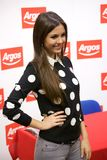 Actress Victoria Justice poses for fans and press stock photography