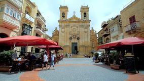 Ensemble of St George square and San Gorg basilica, Victoria, Malta. VICTORIA, MALTA - JUNE 15, 2018: Ensemble of St George square with medieval building of San stock video footage