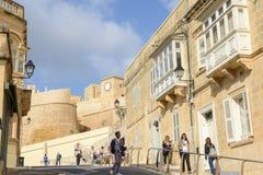 The citadel of Victoria on Gozo island, Malta. Victoria, Malta - 30 October 2017: people walking at the citadel of Victoria on Gozo island, Malta Stock Image